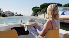 Dream Vacation: woman enjoying a walk on the boat. Floating through the channel Stock Footage