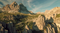 Aerial view of Tre Cime mountains in Dolomites on sunny summer day Stock Footage