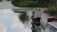 House Boat on Canal with reflection of clouds Stock Footage