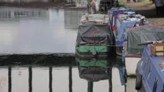House Boat on Canal with people walking by the side Stock Footage