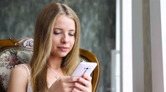 Cool girl typing message on smartphone Stock Footage