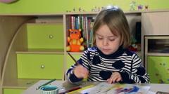 Little kid draws something near the  Bookshelf. Stock Footage