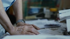 Hands adult male on the table. The man leaned on the tabl Stock Footage