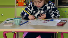 Little kid draws something near the  Bookshelf. Stock Footage