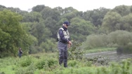 Flyfisherman fishing from riverbank, Irish countryside Stock Footage