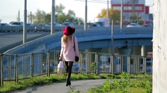 Girl in a red hat is on the city Stock Footage