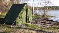 Oldschool tent near forest lake pan Stock Footage