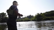Fisherman in river, afternoon light Stock Footage