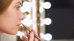 Sensual girl applying cosmetic with lip liner Stock Footage