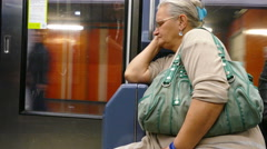 Paris, France. Elderly lady seated on a Metro train. Stock Footage