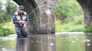 Fly-fisherman fishing in river Stock Footage