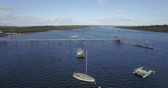 Slow aerial rise above Warneet pier over the inlet Stock Footage