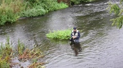 Upper view of fly-fisherman in river Stock Footage