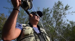 Closeup of fly-fisherman in action Stock Footage