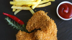 Breaded crispy chicken wing nuggets fried  sauce french fries food dish Stock Footage