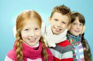 Portrait of three little children in warm clothing Stock Photos