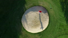 Golfer chips out of Bunker and Celebrates. Stock Footage