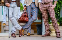 Stylish men in trendy suit with a walking stick and  leather valise stand on the Stock Photos