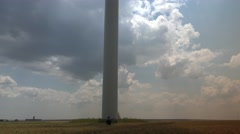 Wind power generator on golden wheat field..Eco power concept.Tilt up 4k UHD Stock Footage