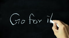 Chalk drawing - Go for it on blackboard Stock Footage