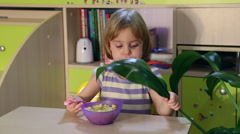 Hungry little kid eats. Stock Footage