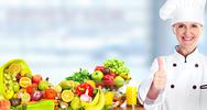 Chef woman with vegetables and fruits. Stock Photos