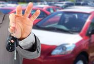 Dealer hand with a car key. Stock Photos
