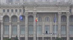 BUCHAREST ROMANIA-Circa August 2016:Romanian Parliament and three flags 4k UHD Stock Footage