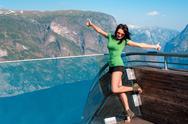 Excited woman tourist at Stegastein Viewpoint Stock Photos