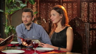Young couple at the restaurant Stock Footage