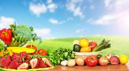 Vegetables and fruits over blue sky background. Stock Photos