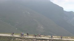 Mountain bikers adventure on the plateau  of Bucegi Romania 4k UHD Stock Footage