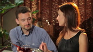 The man and woman in the restaurant Stock Footage