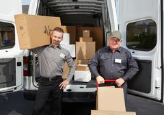 Group of delivery man with a parcel. Stock Photos