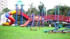 Children play on playground in a public park of Loei province Stock Footage
