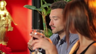 The couple are talking in the restaurant Stock Footage