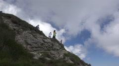 Tourists descending on a narrow  alpine path 4k, UHD Stock Footage