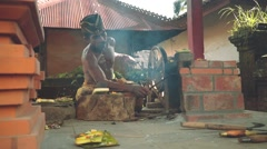 Balinese iron smith making tools traditional way in village, slide Stock Footage