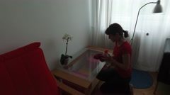 Woman doing chores Wiping glass table at home 4k UHD handheld shooting Stock Footage