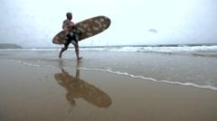 Mature Surfer Dude Rnning through Ocean. Stock Footage