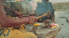 Balinese iron smith making tools traditional way in village, close up Stock Footage