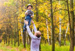 Happy family. Father and baby son for a walk in the autumn Stock Photos