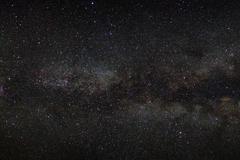 Milky way galaxy on a night sky, long exposure photograph, with grain. Stock Photos