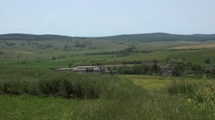 European rural countryside landscape with green hills panoramic view right pan Stock Footage