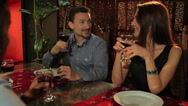 The couple are talking with friends in restaurant Stock Footage