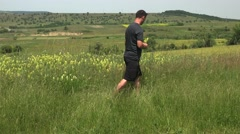 Man picking wild flowers from the hills for hir girlfriend 4k UHD Stock Footage