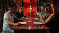 People clink glasses in the indian restaurant Stock Footage