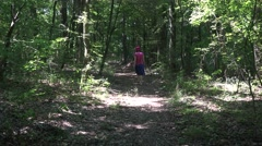 Woman with with blue skirt walking through the woods sound 4k UHD Stock Footage