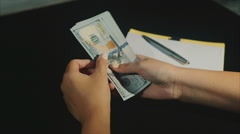 Concept of family budget planning woman hads count dollars and write wastes Stock Footage