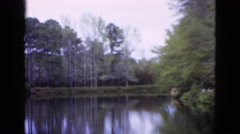 1952: a beautiful pond surrounded by a lush green environment CAMDEN, NEW JERSEY Stock Footage